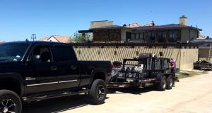 RSM-loaded-trailer-with-home-in-background